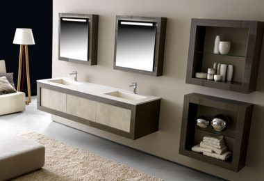 A modern bathroom with ample shelving featuring cabinetry from Karol's Xil collection