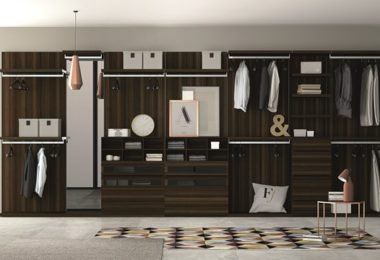 Dallagnese walk in wardrobe featuring oak cabinetry